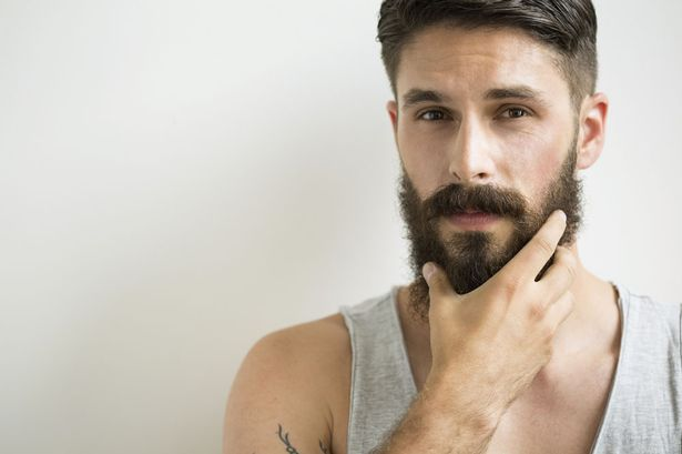 man-rubbing-beard